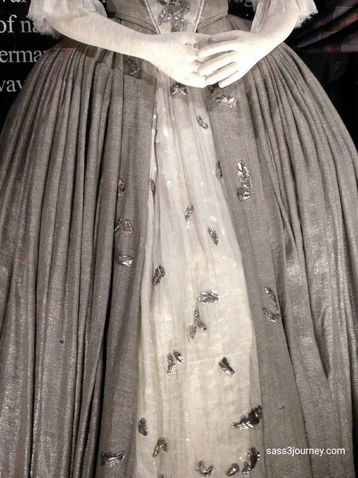 Terry Dresbach's wedding dress was inspired by gowns made with metallic embroidery. Each leaf and acorn embroidered by hand with metal strands and aged.